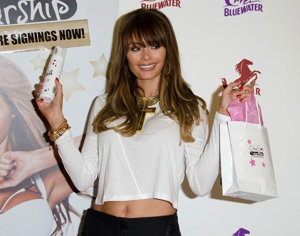 "Chloe Sims at the launch of her new tanning range with Boots pharmacy, ""Chloe Sims Starship Tanning,"" at the Bluewater Shopping Centre in Kent, United Kingdom, on December 14, 2013"