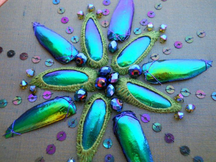 Beetle wings, Swarovski Crystals, glass cut beads, peacock colour sequins and embroidery cotton on green and blue shot silk.