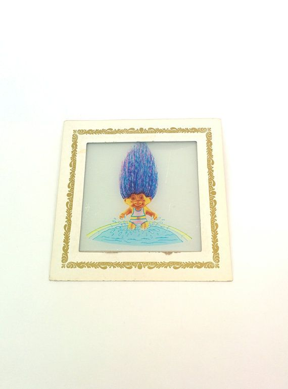 Check out this item in my Etsy shop https://www.etsy.com/listing/196154502/vintage-wall-hanging-troll-doll-pop-art