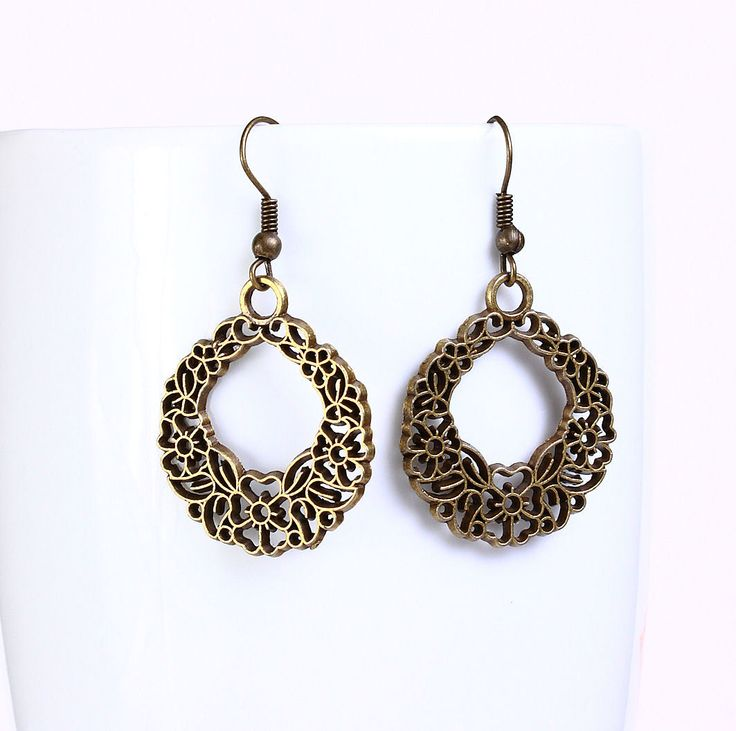 Khalliah Design - Round filigree flower dangle earrings - antique brass, $15.00 (http://www.khalliahdesign.com/round-filigree-flower-dangle-earrings-antique-brass/)