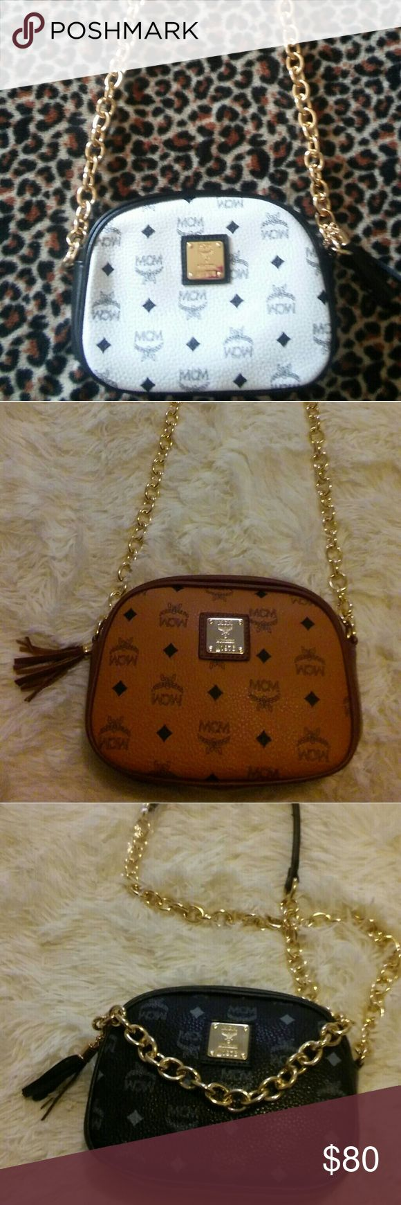 Sold out MCM chain strap crossbody purse MAKE ME AN OFFER!!!!! 3 colors MCM Inspired small purses. Gold chain strap crossbody purses. Price reflects authenticity. MCM Bags Crossbody Bags
