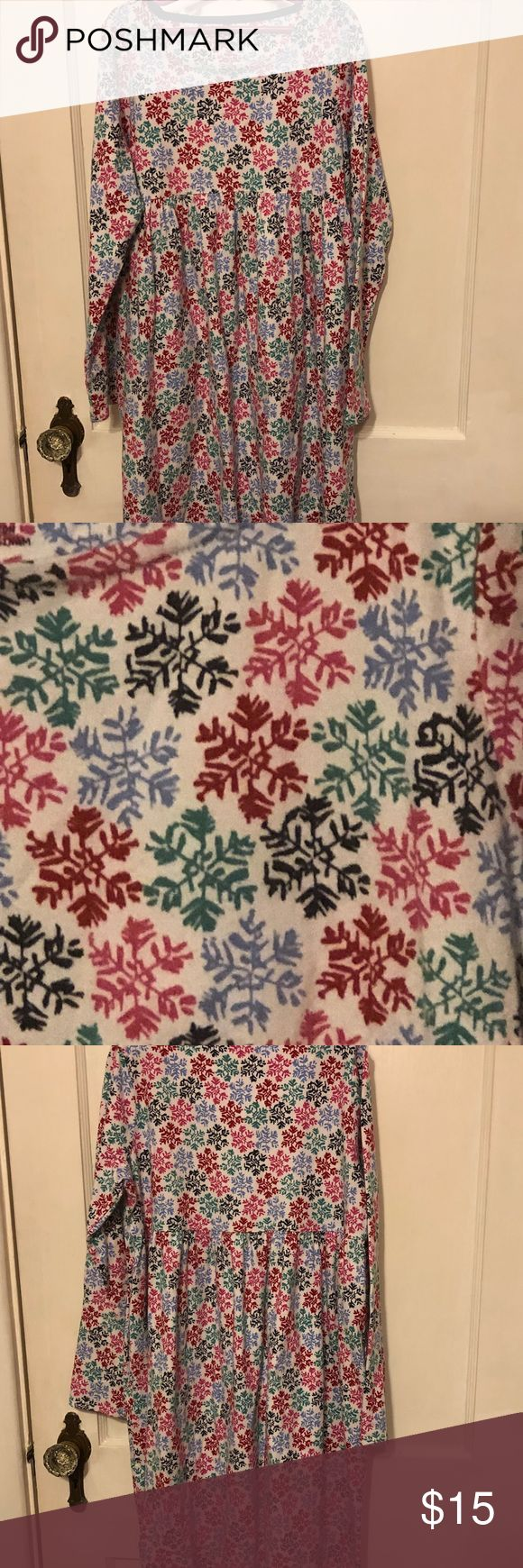 """Lands End Kids snowflake dress size M 10+-12+ This is a Lands End Kids Dress.  It has a snowflake design.  Snowflakes are red, pink, green, light blue and navy blue.  100% cotton.  Size M (10+-12+).  Measures 17"""" armpit to armpit and 33.5"""" shoulder to hem.  It's in great condition. No rips, stains or tears. Lands' End Dresses Casual"""