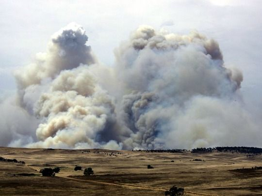 Smoke billows into the sky over grazing land in the Carlaminda area near Cooma, NSW. (Photo: Ray Strange/Daily Telegraph)