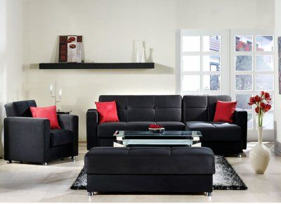 Living room - black couches with red pillows no leather sofass though yuc kk