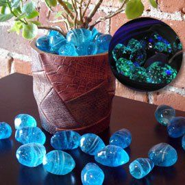 Glowing Moon Rocks Illuminate a pathway, flowerbed or aquarium! Light up a walkway, container plant or fish tank with glow-in-the-dark moon rocks! The smooth glass stones contain luminescent crystals that store the suns energy during the day and glow soft