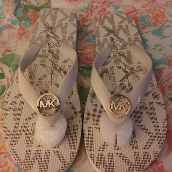 "Michael Kors ""MK"" off white/cream flip flops Michael Kors ""MK"" off white / cream flip flops in size 8. Nice color that will go just about everything! Authentic! Michael Kors Shoes Sandals"