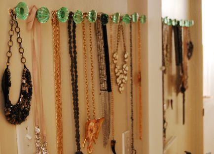 use glass or ceramic doorknobs for necklace organization.