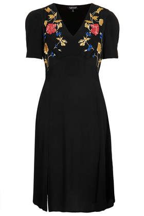 V neck tea dress with placement floral embroidery and short sleeves. Side split to embrace spring!