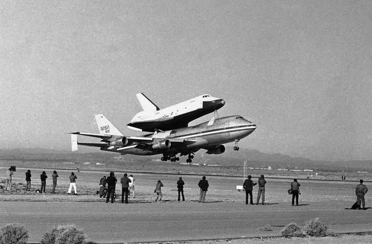 February 18,   1977: Space shuttle Enterprise on its maiden flight  -    America's Space Shuttle Enterprise, rides atop a giant 747 on its first test flight at Edwards Air Force Base, Calif. In the right foreground is a  chase plane.