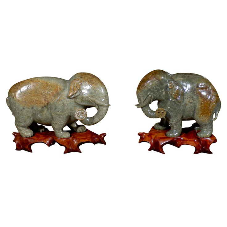 Near Pair Chinese Carved Jade Elephants on Stands carved mottled green and brown standing pachyderms with turned trunks on carved hardwood base.   $1,850