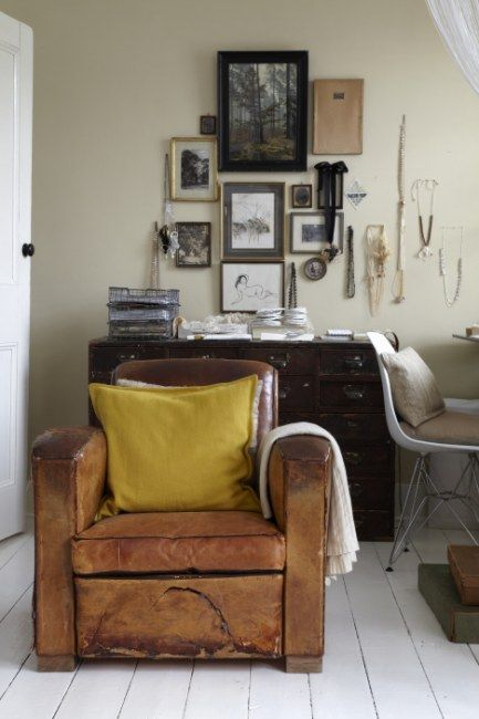white floor, dark brown couch, taupe brown walls, splash of color (maybe pillow from color in grandma's painting)