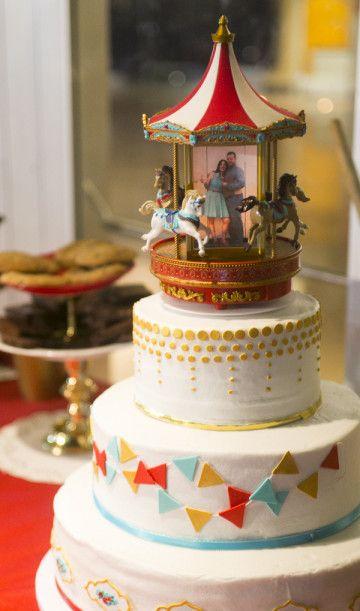 Carnival Themed Wedding Cake with a Carousal topper|Fun Retro Arizona State Fair Wedding|Photographer:  Laura Segall Photography