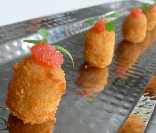one of our favorite elegant appetizers - bacalao fritters with finger lime caviar
