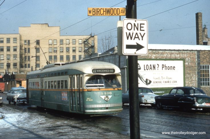 Mid-1950s CTA PCC #4406 is at Clark and Birchwood, just leaving Howard Street, north end of Route 22. Now the #22 Clark Street bus route.
