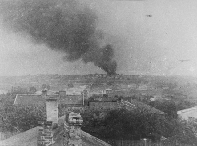 Majdanek concentration camp, a view from the village Dziesiata. In the background - smoke from a burning pyre of corpses.