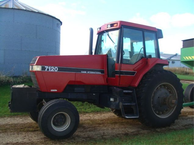 Machinery Pete: Strong Prices on Red Tractors, Combine & Equipment on MN Farm Auction