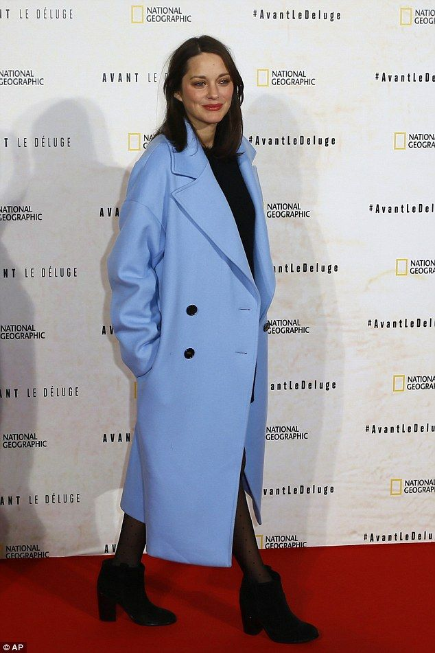 Such a good look: The 41-year-old covered up her bump in a statement cornflower blue coat...
