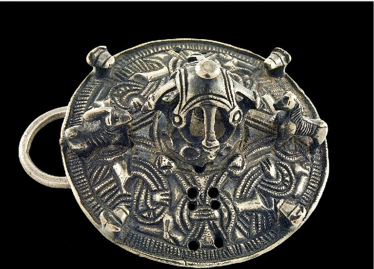 Viking age / This silver disc brooch belongs to a group of very rare, richly decorated garment clasps. Many abstract representations of animals can be seen.
