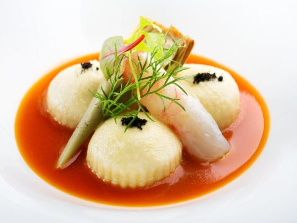 Potatoes ravioli filled with liquid artichokes, bouillabaisse, raw prawn and black olives powder - The ChefsTalk Project