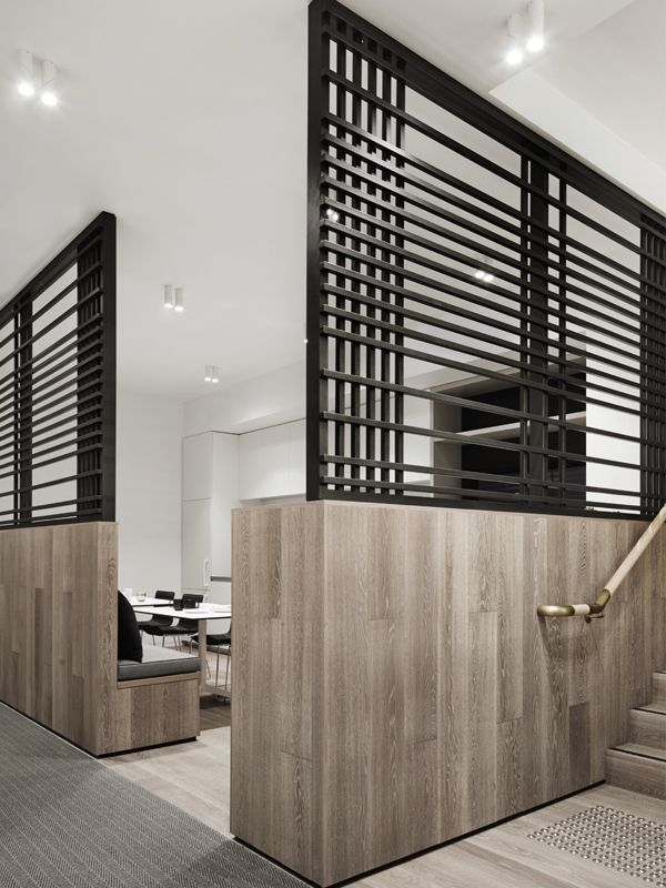 Little Group, Mim Design. The kitchen and breakout area is separated from the general office area by timber clad walls that feature a black steel custom made lattice ...