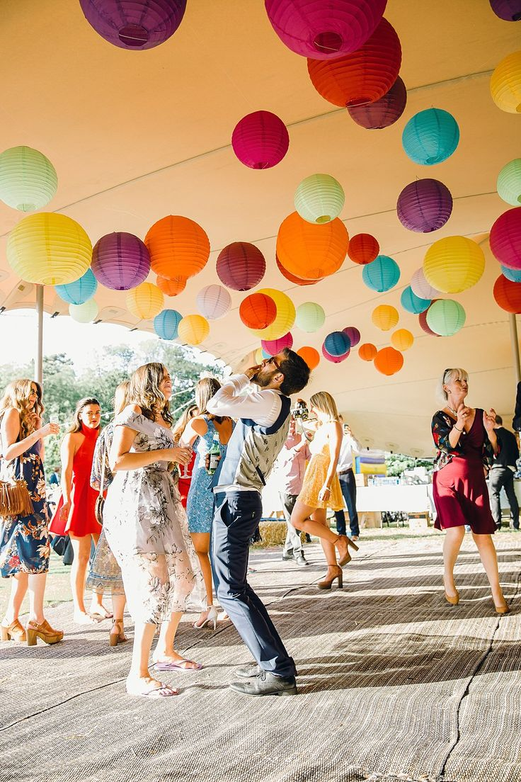 Rainbow of Hanging Paper Lanterns | Bright Music Festival Wedding | Outdoor Stretch Tent Reception | Ronald Joyce Wedding Dress | Jessica Reeve Photography | http://www.rockmywedding.co.uk/jes-tommy/
