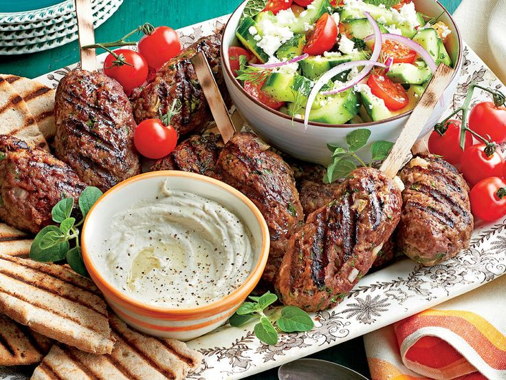 Spiced Beef Kabobs with Herbed Cucumber and Tomato Salad | Serve this zesty beef with toasty bread and a tangy herb salad.
