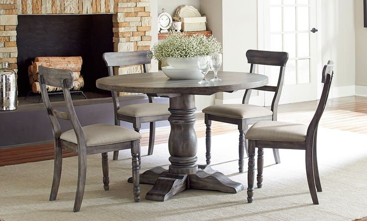 The Muses Round Dining Room Set w/ Ladderback Chairs by Progressive Furniture creates casual cottage styling that can work from coast to coast. Comes in distressed dove gray finish.