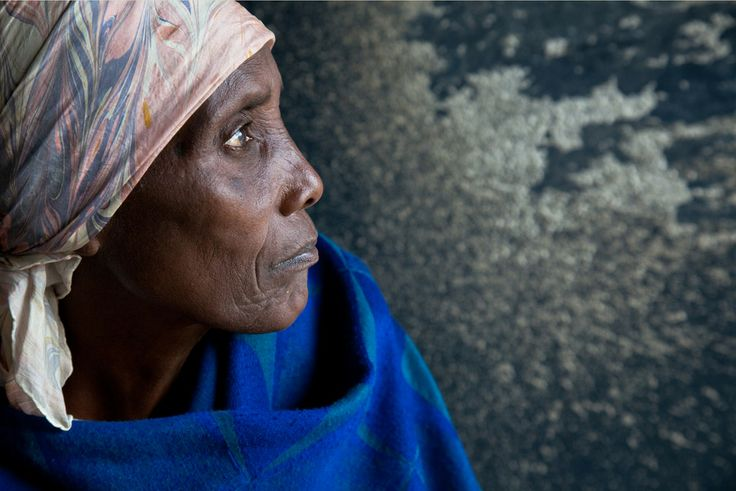 A portrait of a woman affected by the Rwandan genocide. This woman lost her husband, all eight of her children and was severely wounded.
