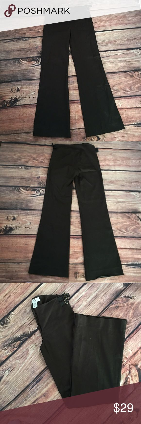 "Armani Exchange Subtle Stripe Boot-Cut Trousers Pre-owned in good condition.  These subtle striped trousers from Armani Exchange are as timeless as they are chic--a wardrobe must for polished workweek style. Enhancing the look are adjustable side faux belt detail.  32"" inseam; 22"" leg opening; 9 1/2"" front rise; 11"" back rise (size 2) Front zip, one button and hook & eye closure No pockets 62% cotton, 34% nylon, 4% spandex Machine wash cold, tumble dry low Imported Armani Exchange Pants Boot…"