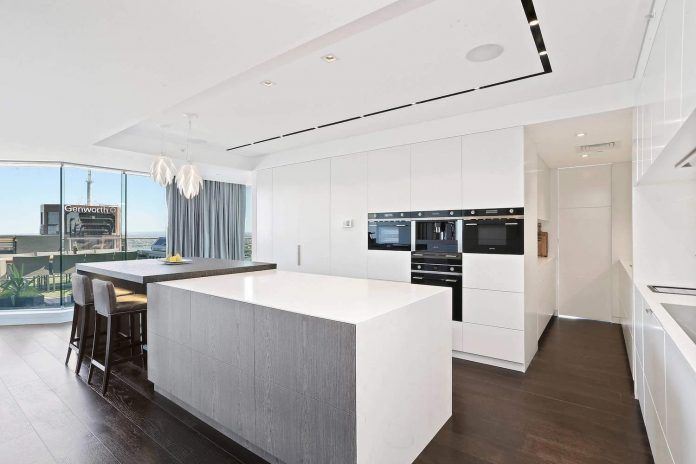 Elegant North Sydney penthouse has streamlined space and sweeping city views - CAANdesign | Architecture and home design blog