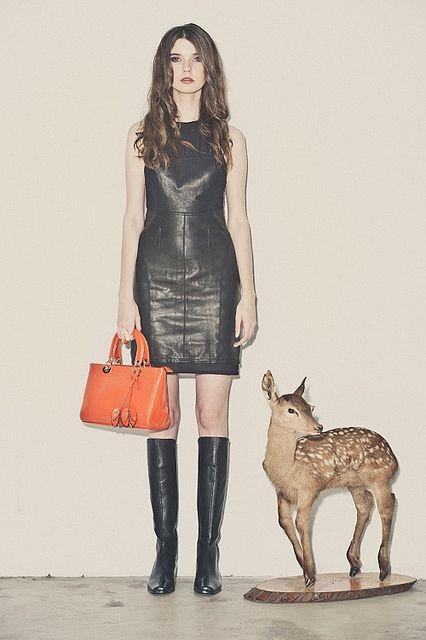 Black leather dress and orange Kelly Brown bag