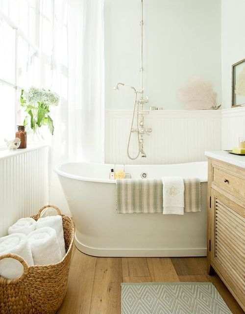 Love the tub hardware! anderson + grant: Baskets of Towels in the Bathroom