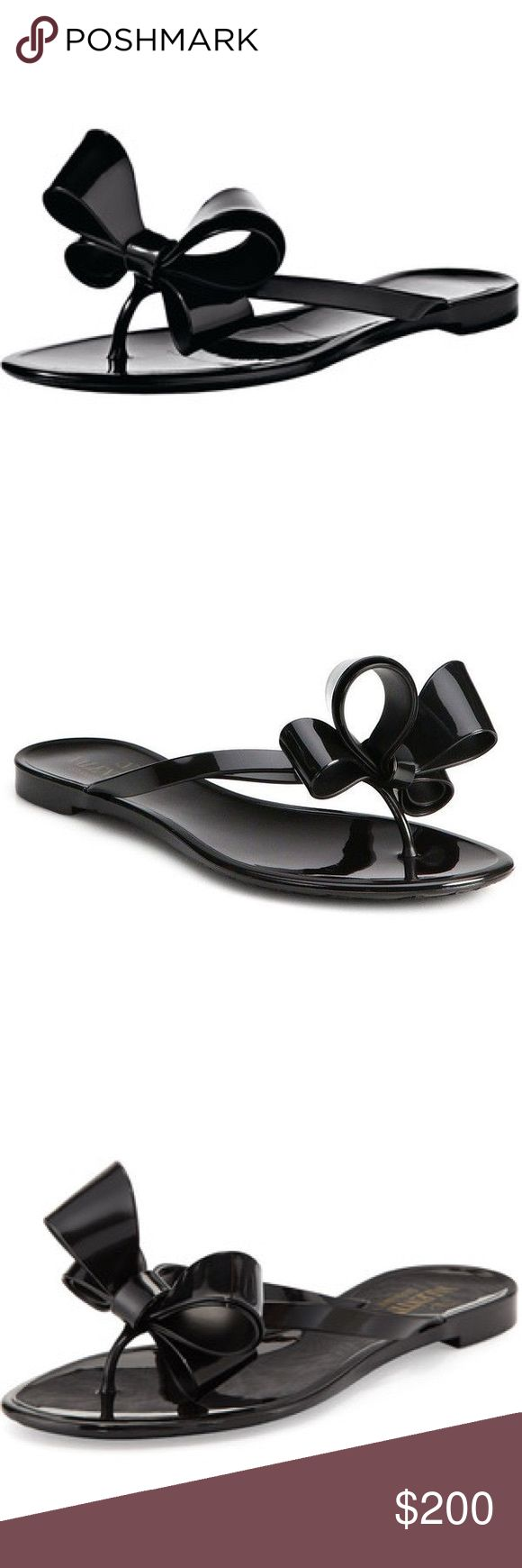 Valentino couture bow jelly flat sandal Valentino couture black jelly sandal size 38. Never worn. Bought size too big and never returned to Saks. Valentino Shoes Sandals