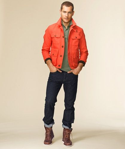 An orange jacket with jeans reflects great personal style especially with some kick-ass boots.