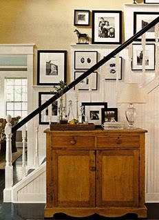White newel post, rails and bottom with dark hand rail.  Nice with pictures behind it.