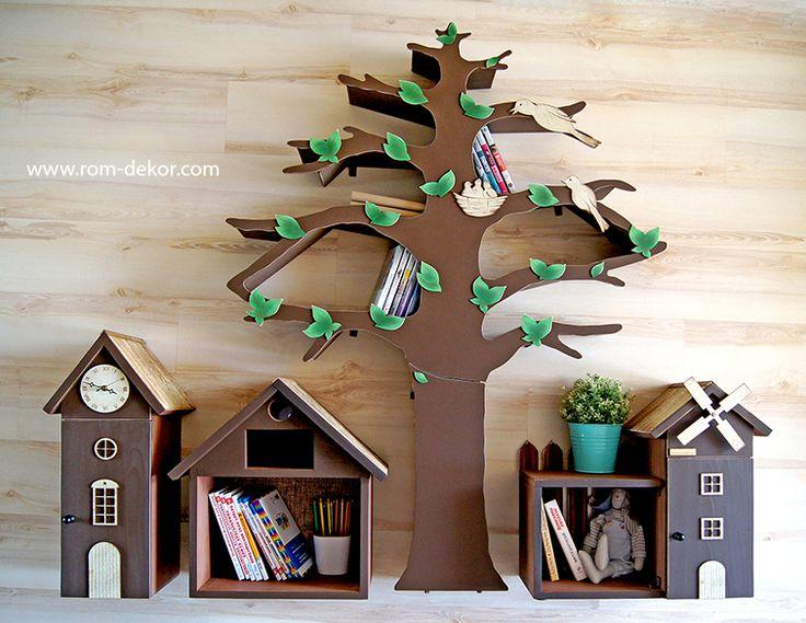 Дерево-стеллаж и маленькие шкафчики в виде домиков для детской комнаты.