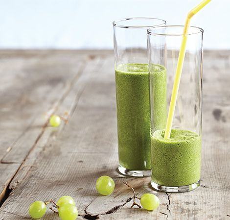 GOING GREEN: 1/2 cup WATER, 2 cups SPINACH, 1 cup GREEN GRAPES, 1/2 cup  PINEAPPLE, 1/2 BANANA, ice