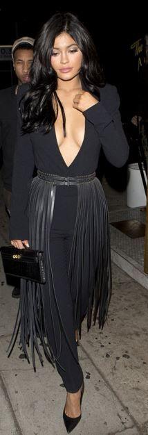 Who made Kylie Jenner's black fringe belt and clutch handbag?