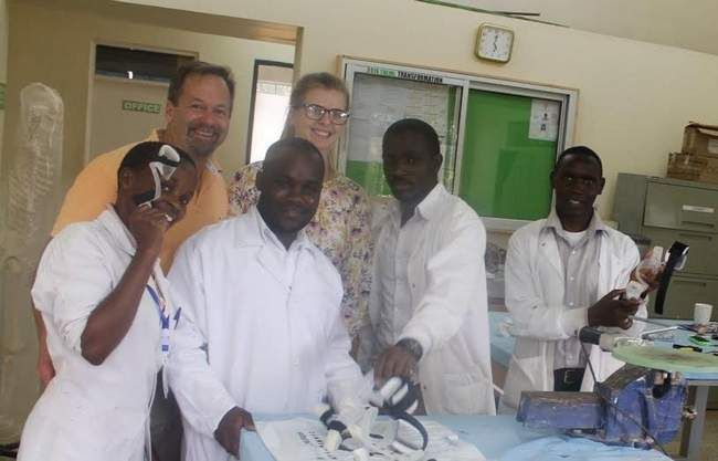 Wells Prosthetist Jerald Cunningham and daughter Jordan with staff at the CURE International hospital in Kenya.  Courtesy photo