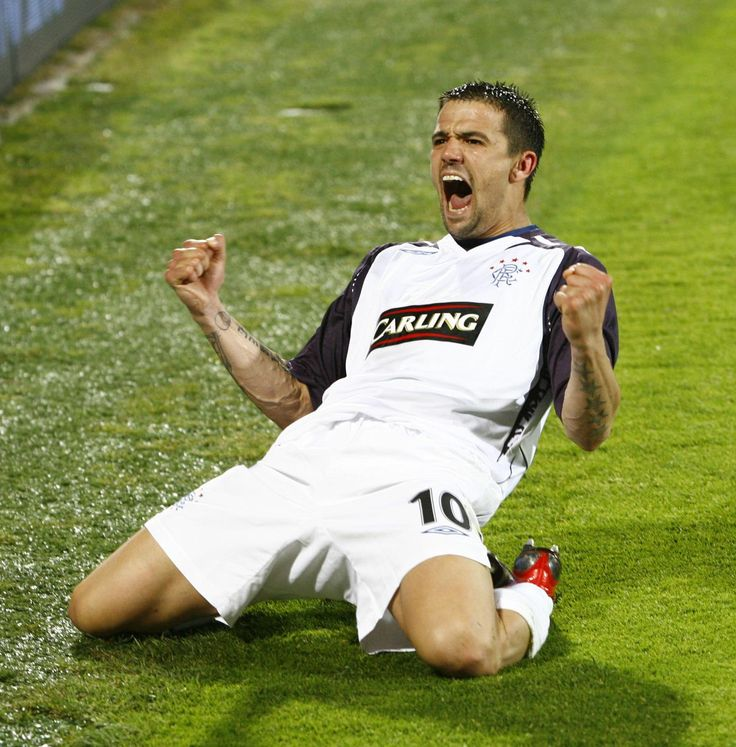 Nacho Novo celebrates after his penalty floors Fiorentina and send Gers to the 2008 Uefa Cup final