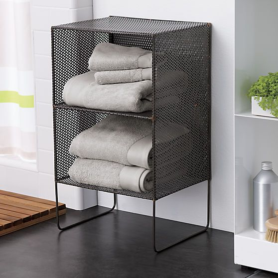 sift 2-story tower | CB2  Industrial mesh cubbies rise single file, two tiers tall, on handcrafted iron frame with exposed brass welding. Shelves shoes, books and wine in the bedroom, office, kitchen or entryway. We like to grid the wall with multiples to maximize small spaces.