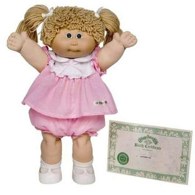 Can't mention the 80s without a Cabbage Patch Doll. Mine looked like this without the pigtails. Her name was Nessy Evita and she had Xavier Roberts signature on her booty.