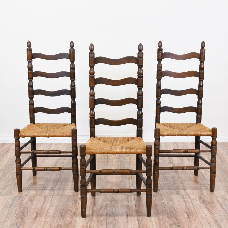 This set of 3 ladder back chairs are featured in a solid wood with a glossy dark walnut finish. These chairs are in great condition with carved spindle details, tall ladder backs and woven rush seats. Early colonial style chairs perfect for a small dining table! #colonial #chairs #chair #sandiegovintage #vintagefurniture