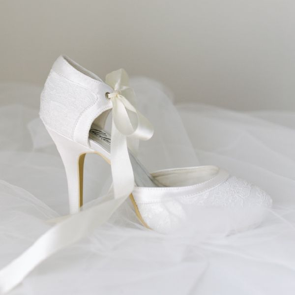 Ballerina Heel Lace Wedding Shoes by Pearl & Ivory ®  - Find more elegant wedding shoes from our collection www.pearlandivory.com/bridal-shoes.html. Photography by Yolande Marx #PearlandIvory #WeddingShoes #Lace #BallerinaHeels #LacePumps #BridalShoes