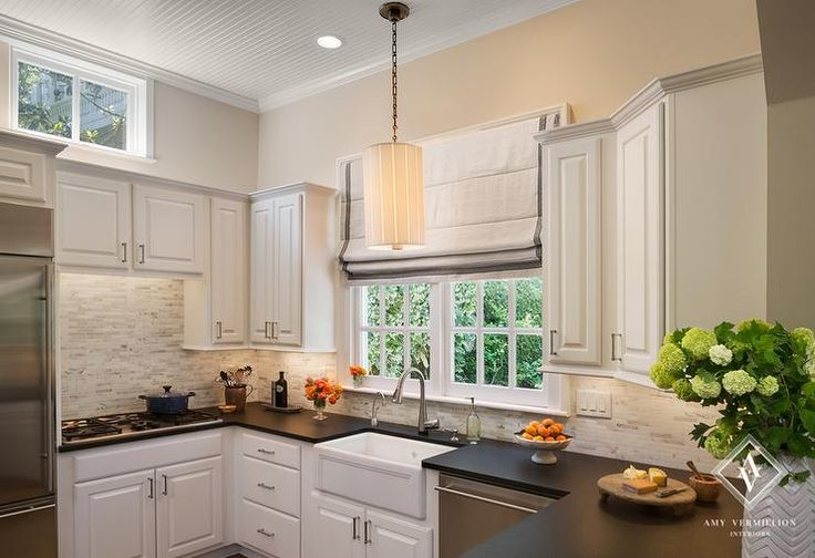 Small U Shaped Kitchen Features White Raised Panel
