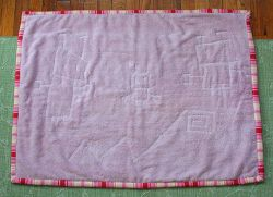 Not clothing, but old towels.  Make a bath mat, a play mat for baby, or whatever you need.  Takes two towels.