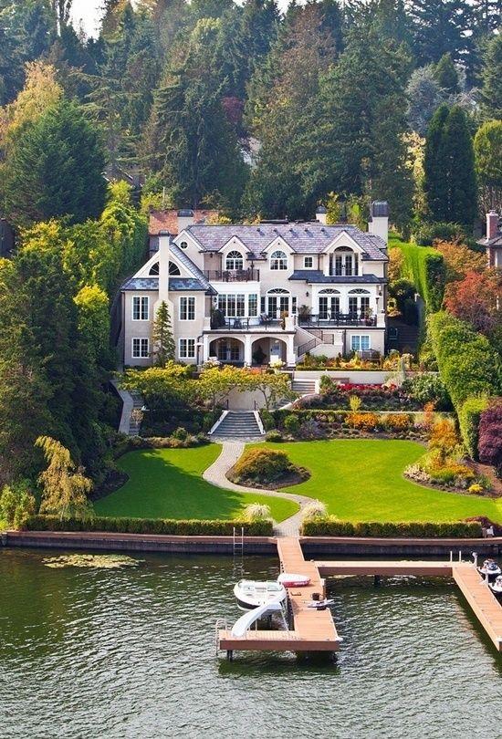Beautiful home, I would LOVE it here :)  woods, lake, sun, big yard, big house, what more do I need?