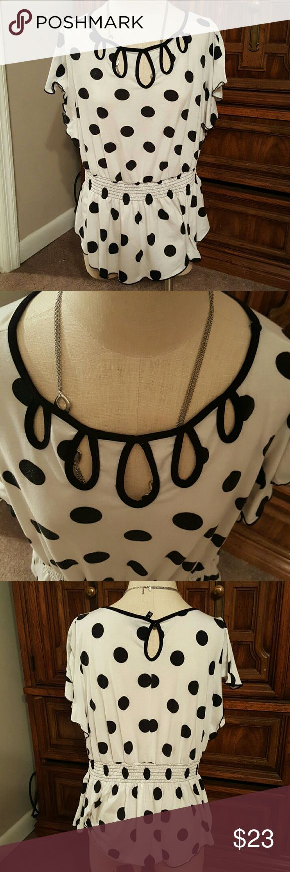 Polka Dots 4 life Beautiful Black and White blouse with batwing sleeves accenting like cutouts on the chest of the shirt and a waist scrunch. Gently worn but no imperfections. Worn perfectly with some black capri or skinnies. Soft business attire. new directions Tops