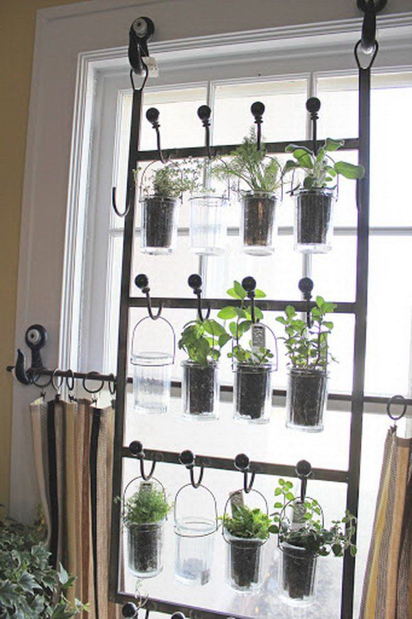 Indoor garden from hooks and rods. http://hative.com/cool-diy-indoor-herb-garden-ideas/
