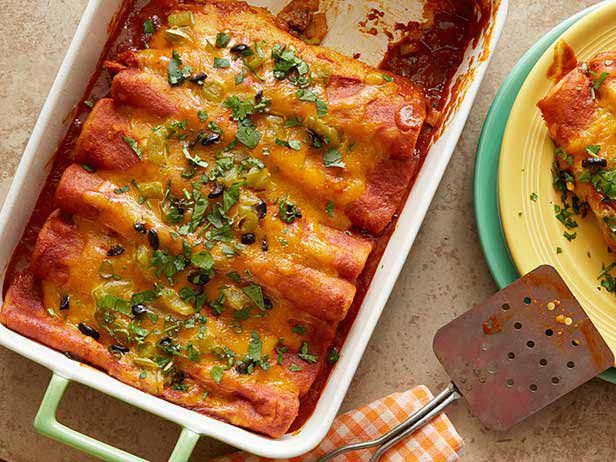 Simple Perfect Enchiladas  I would use Enchilada sauce straight from the can instead of adding broth next time Added salsa, olives, fresh tomatoes and can of rotel tomatoes to the beef mixture.  Good!